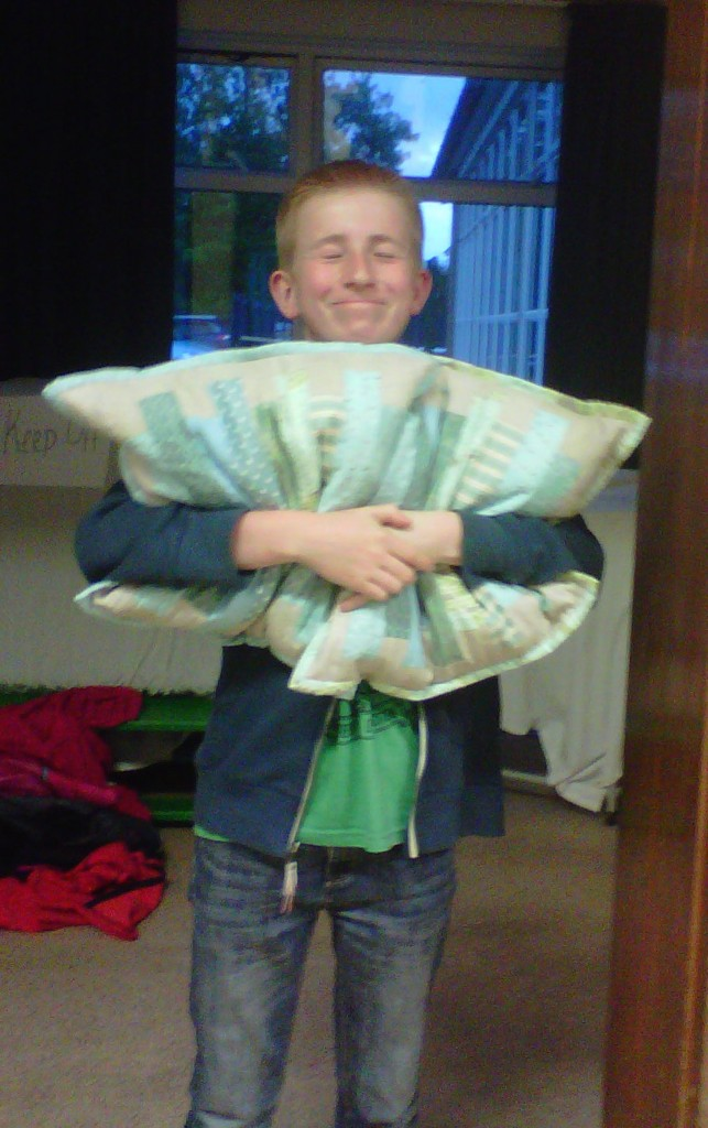 Happy raffle winner or one chap and his cushions